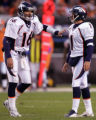 Denver Broncos quarterback Jake Plummer pats a dejected Jason Elam after Elam missed a 43-yard...