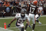 Denver Broncos corner back Darrent Williams, left, celebrates breaking up a pass to Cleveland...