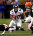 Mike Bell tries to run through an arm tackle by D'Qwell Jackson in the third quarter of the Denver...