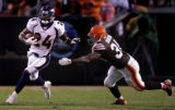 Champ Bailey tries to avoid a tackle by Reuben Droughns after an interception by Bailey in the...