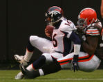 Jake Plummer is sacked by Alvin McKinley in the second quarter of the Denver Broncos against the...