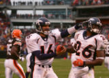 Jake Plummer congratulates Tatum Bell after a 9-yard touchdown run in the second quarter of the...