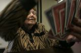 Arlene Barr, CQ, 82, a recipient of medical insurance through AARP and Medicare, arranges her...