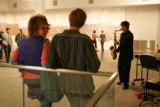 10: 48 p.m. October 7, 2006.   Museum goers listen to Danny Meyer, right, of Boulder, plays the...