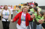 DLM01907   Donna Nelligan, left, of Littleton and Carrie Newman, center, of Engelwood run down a...