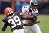 Denver Broncos wide receiver Javon Walker breaks a tackel from Cleveland  Browns defender Daven...