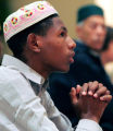 Kadir Jara (cq), 17, from Aurora, prays at a mass prayer at the DTC Marriott Monday morning...
