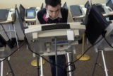 Colorado State University student Tim Pennington (cq), 22, a senior liberal arts major, votes on...