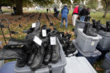 Volunteers place boots by, by states, at the The Eyes Wide Open memorial, sponsored by the...