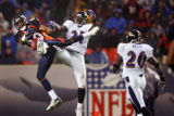 The Baltimore Ravens' Chris McAlister (#21, CB) breaks up a long pass intended for the Denver...