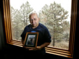 DLM02718   John Crisci, 65, holds a photo of himself and his partner of 30 years Michael...