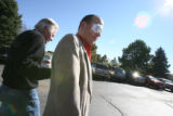 Stephen Crout, (cq), escorts Peter Russell, (cq), from his cornea transplant at the Littleton Day...
