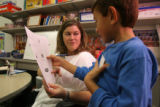 Denise Hitchcock, cq, helps her student Rodrigo Velazquez, 7,  during a Title 1 reading bilingual...