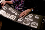 Eldon Yetter looks through a family photo album. The morning of Dec. 14, 1961, he was initially...