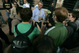 Bill Ritter shakes hands and answers questions from students after his rally at the EMC at the...