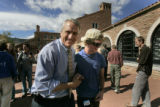 Bill Ritter gives a big hug to his friend's son Kevin Powers, (cq) a freshman at CU with a major...