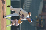 Greek Olympic pitcher Clinton Zavaras delivers a pitch during the first inning of their exhibition...