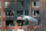 (NYT64) NEW YORK -- Oct. 11, 2006 -- NY-CRASH-15 -- Firefighters extinguish a blaze in a...