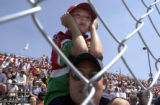 (DENVER, Colorado. August 15, 2004) John Anton , 7 doesn't seem too impressed as he views the 3rd...