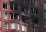 (NYT38) NEW YORK -- Oct. 11, 2006 -- NY-CRASH-3 -- Firefighters look on from burned out apartments...