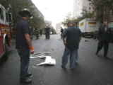 (NYT47) NEW YORK -- Oct. 11, 2006 -- NY-CRASH-5 -- Investigators and rescue workers look at a...