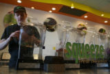 Squeeze employee, Dan Neiswender, cq, prepares a smoothie at the Parker store, Wednesday Oct. 18,...