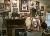 """Miss"" Mary Anthony (CQ), proudly holding a photo of her son, Nuggets forward Carmelo..."