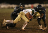 MJM769  Columbine High's Jacob Wright, left,  and Orenzo Davis, right, tackle Bear Creek High...