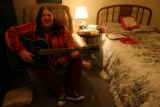 Rebecca Simon sings a song she composed playing along with her 12 string Fender guitar. Every...