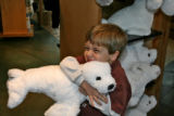 Cole Hajde, four years old, hugs a stuffed animal in the KIBONGI Market at the Denver Zoo, Tuesday...