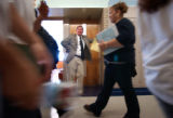 (Denver, Colo., August 16, 2004) Principal Scott Mendelsberg welcomes freshman students as they...