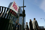 A vote center sign lays folded in the trash across from the Wellington Webb building at Court and...