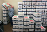 Frank Frazier (cq) a a counting judge at the denver Election Commission stacks absentee ballots...