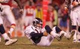 [JPM740] In the fourht quarter, Denver Broncos quarterback Jake Plummer (16) picks himself up...