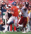 (SAN DIEGO, CAL., JANUARY 31, 1987) Charles Mann of the Washington Redskins reaches out to grab...