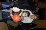 John-Michael Liles gives some tips to his cleanup bowler, 12-year-old Joe McQuiston. (BRETT...