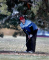 Mark Milligan, cq of Denver rechecks his aim for the 5th hole flag from under a tree Monday Feb....