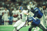 (SEATTLE, WASH., OCTOBER 1, 1995) Broncos quarterback John Elway tries to get away from the...