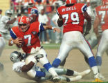(DENVER, COLO., SEPTEMBER 18, 1994) Broncos quarterback John elway is brought down to the dirt by...