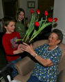 Jack Cameron, left, 8, and his sister Amanda Cameron,10, give a plant to Serafina Gaschler (cq),...