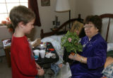 Jack Cameron, 8, gives a plant to Delphina Gonzales (cq), right, Monday morning February 12, 2007...