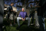 Colorado Rockies Manager Clint Hurdle answers questions by reporters after practice at the Hi...