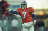 (DENVER, COLO., NOVEMBER 20, 1994) Quarterback John Elway shouts and points during the Broncos...