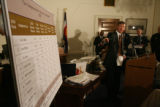 (DLM5933) -  Mayor John Hickenlooper points to the 2006 crime figures listed for individual...