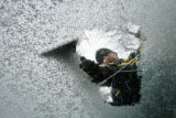(DLM5985) -  Steve Fagaly, 30, scrapes ice off his windshield as he gets ready to go meet a client...