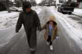 (DLM6338) -  Sarah Alexander, 9, holds her mom's hand as she walks home from Frank Traylor...