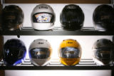 MJM379 Helmets sit on display at  Erico Motor Sports in Denver Tuesday.   Proposed bill, HB 1117 ...