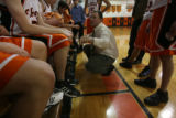 Eric Moore, (cq), Flagler junior varsity coach, tries to fine tune the team during play against...