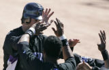 Colorado Rockies #17 Todd Helton celebrates with his team after scoring a run against the Chicago...