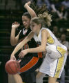 Grand Junction's Marlena Diaz, left, gets the ball defelected off her by Legacy's Quincey Noonan,...